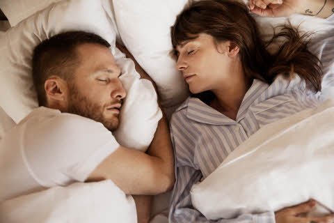 couple sleeping in bed at scandic hotels