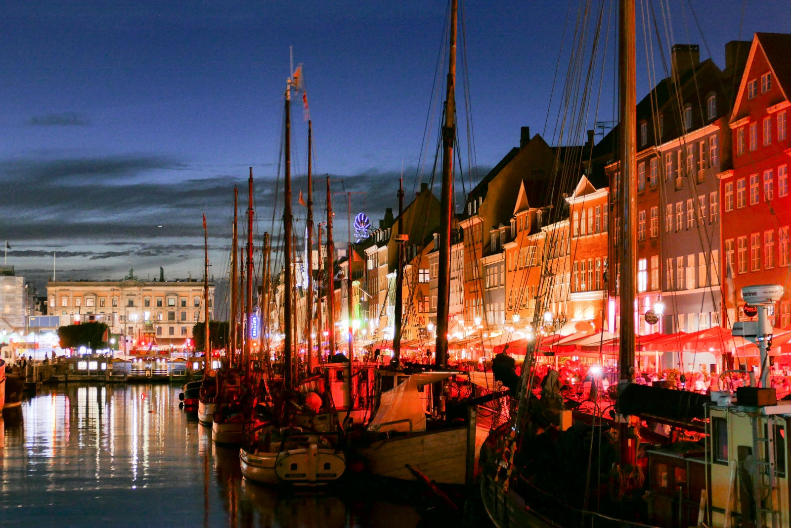 Nyhavn and the restaurants by night. Boats along the restaurants.