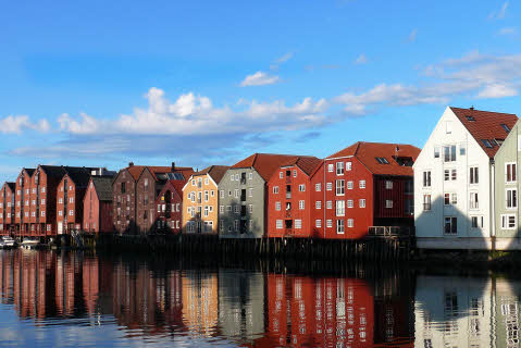 By the waterfront, colourful facades of the houses in Bakklandet Trondheim